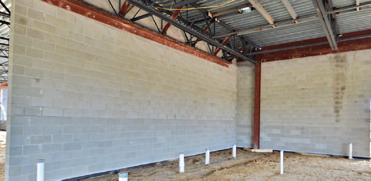 Having a client who believes in taking advantage of using ALL of a material's attributes drove HED to maximize CMU, making minimal modifications to perimeter walls so they could also carry shear loads.