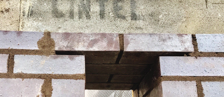Lintels were installed as one-piece units, slid in above brick jambs and under CMU bond beam already in place.