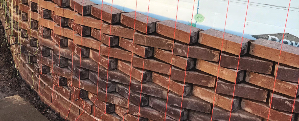 Brick rotates gradually, increasingly needing more of the wall per brick in length. This detail wasn't part of the equation until after the first three courses were installed in running bond fashion to facilitate flashing installation