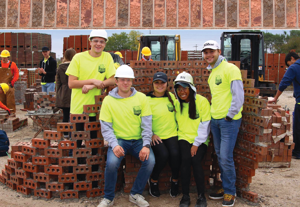 Iowa State engineering students pose by their finished bricklaying project.