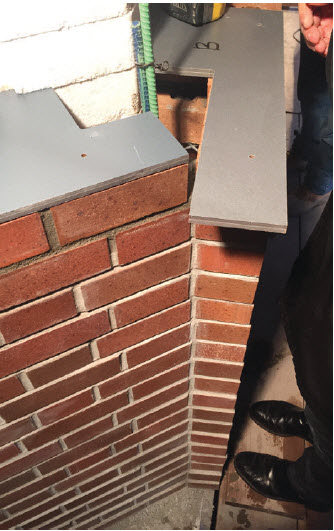 An example of two-brick offset tools being used to check an outside fold of the exterior brick façade. Structural strategy for exterior brick was thought of as a series of brick piers which follow the façade geometry. Steel reinforced piers were filled with grout to tie brick to the building structure.