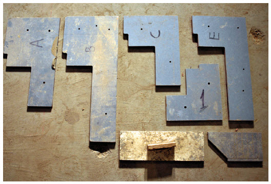 Offset tools made for bricklayers are used to project the face of the foam template to the face of the finish brick.