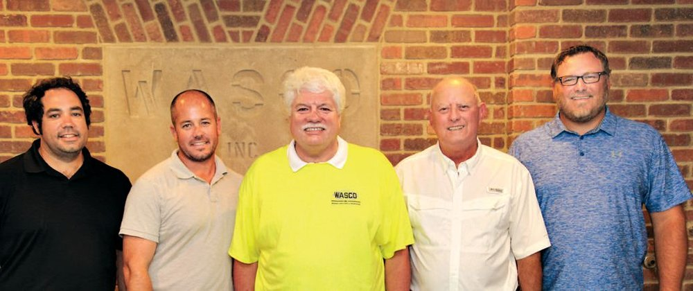 Representing the 4th and 5th generations of Snead family bricklayers are Trey Sneed, Adam Sneed, Andy Sneed, Brad Procter and Brian Procter.