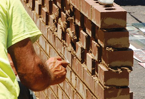 WASCO superintendent Donnie Dickerson strikes the joints of Centric Architecture's wall. Yes – SAM laid each brick with precision.