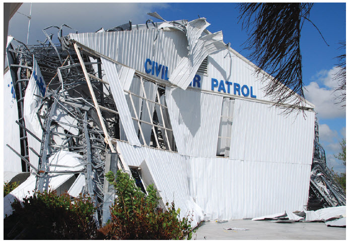 The metal Civil Air Patrol Building for Collier County was peeled back 100 – 150 feet until themasonry portion of the structure stopped the building's total unraveling.