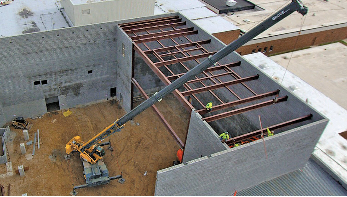 Auditorium was exposed to wind gusts up to 52mph. Internal wall bracing kept construction workers safe and allowed for construction progress to continue on days with high winds. To provide additional support, adjacent intersecting walls were built concurrently.